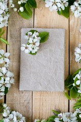 Natural wooden background with white flowers fruit trees and spa