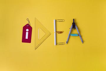idea written with office supplies