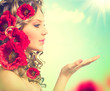 Beauty girl with red poppy flowers hairstyle and open hand