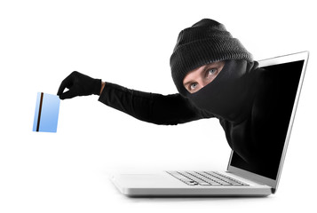 hacker out of computer stealing credit card cyber crime concept