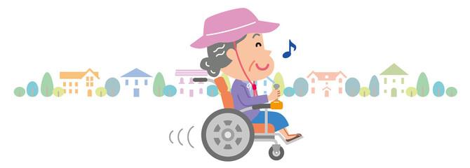 電動車椅子 高齢者 おばあさん 家並み