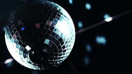 Discoball mirrorball spinning reflecting light into a club venue