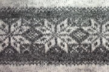 background gray knitted jacquard pattern closeup