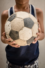 Children hold the old football