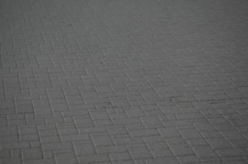 Immagine di un marciapiede in mattoni di cemento