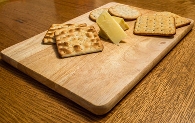 Wooden Cheeseboard on a Dining Table