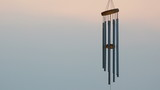wind chime tube mobile in breeze. poster