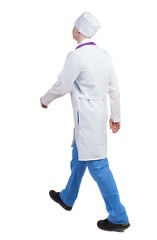 Back view of walking doctor in a robe hurrying to help the patie