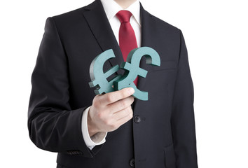 Businessman holding euro and pound signs with clipping path