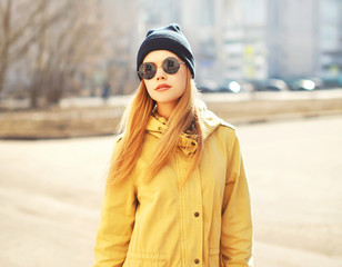 Fashion portrait of pretty hipster blonde girl outdoors in sunny