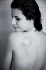 Black and white portrait of beautiful woman relaxing in shower