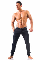 Shirtless musculeman with elegant pants, standing, isolated