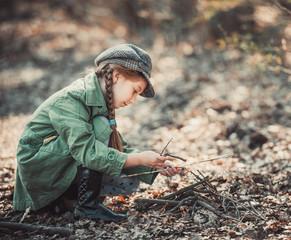 little girl making a bonfire