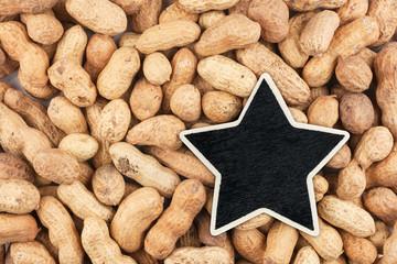 Star, pointer, price, tag, lies on peanuts