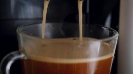 Slowmotion pouring Coffee dispenser with cup of coffee.