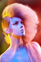 Fashion model with professional colorful makeup and hairstyle.