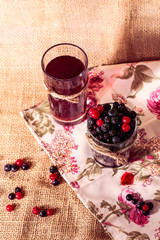 glass with berries and fruit compote