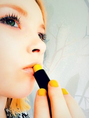 Girl with yellow cosmetic