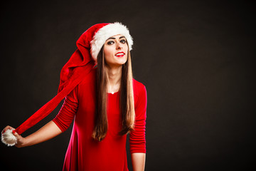 Attractive woman in christmas hat.