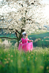 Happy little fashionista and blossoming cherry tree.
