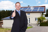 Businessman With Thumbs Up In Front Of House