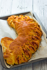 Savory pie with bacon and soft cheese
