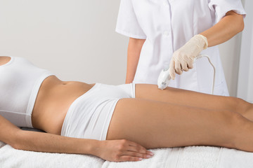 Woman Receiving Epilation Laser Treatment