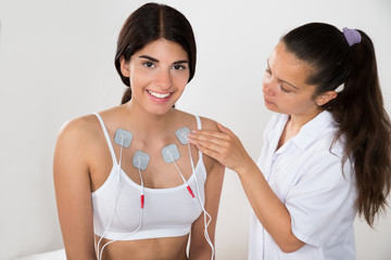 Happy Woman Getting Electrodes Therapy