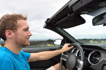 Car driver - young man driving convertible