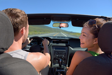 Couple driving car on road trip travel vacation