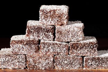Group of Lamingtons with a dark background.