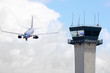 Air traffic control tower with jet airplane