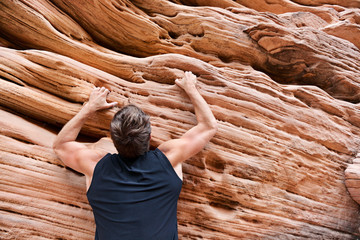 Climber man free climbing on rock