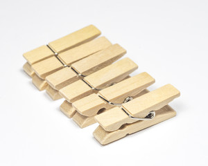 Wooden Cloth Pegs with on White Background.