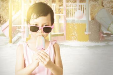 Lovely child enjoy ice cream at pool