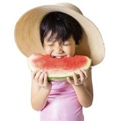 Lovely kid eating watermelon in studio