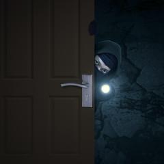 Robber sneaking through door