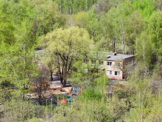 nursery school in green woods in sunny day
