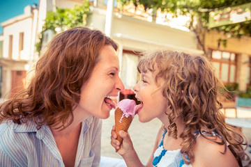 Mother and child eating ice-cream