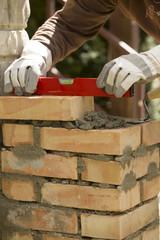 leveling the masonry bricks