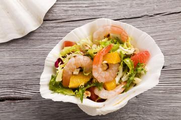 Shrimp salad with grapefruit, orange and roasted peanuts. - Serv