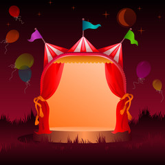 circus tent with balloons at night