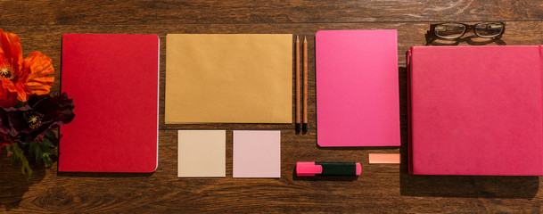 Pink notebooks on desk