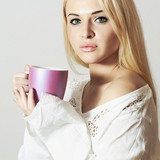 Beautiful blond woman drinking Tea.Girl with Cup of Coffee
