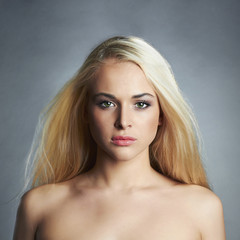 beautiful young woman with long hair.Blond girl