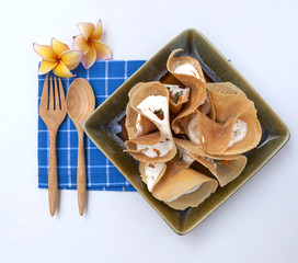 Thai crispy pancake on blue napkin