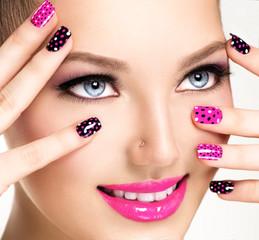 Woman portrait close up. Bright Colors. Manicure and makeup