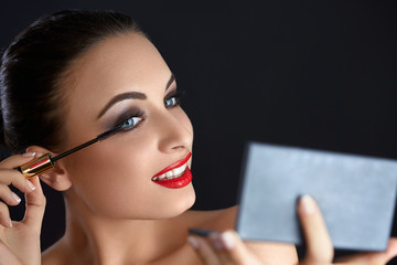 Make-up. Beautiful Woman Doing Makeup. Mascara Brush. Red Lips