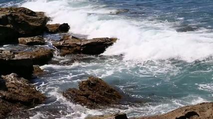 Wave breaking on rocky coast