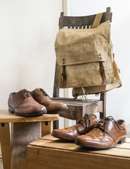 Vintage male accessories.Backpack bag and leather shoes.